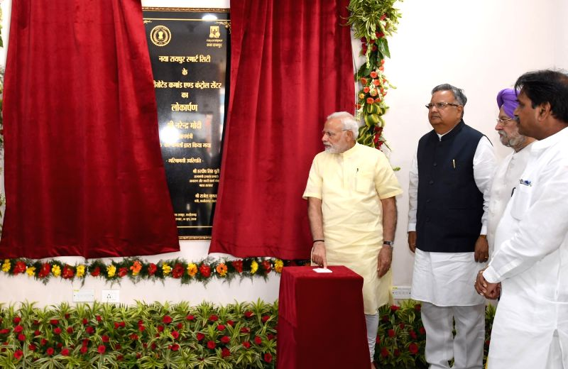 Prime Minister Narendra Modi unveils the plaque to inaugurate the Integrated Command and Control Centre for Naya Raipur Smart City, in Raipur on June 14, 2018. Also seen Chhattisgarh Chief ... - Narendra Modi and Raman Singh