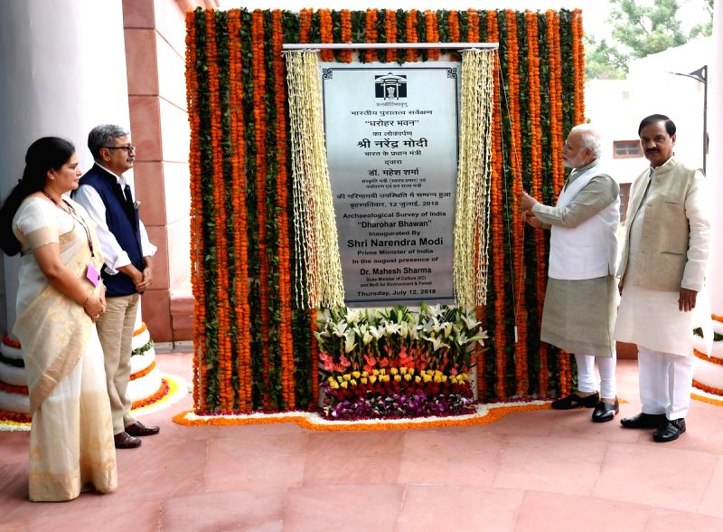 Prime Minister Narendra Modi unveils the plaque to inaugurate 'Dharohar Bhawan'- the new building of Archaeological Survey of India along with Union MoS Culture Mahesh Sharma, in New Delhi ...(Image Source: IANS/PIB)