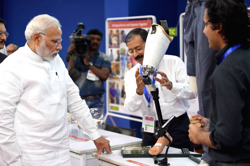 Prime Minister Narendra Modi visits the exhibition at the Indian Institute of Technology, Bombay, in Mumbai on Aug 11, 2018. - Narendra Modi