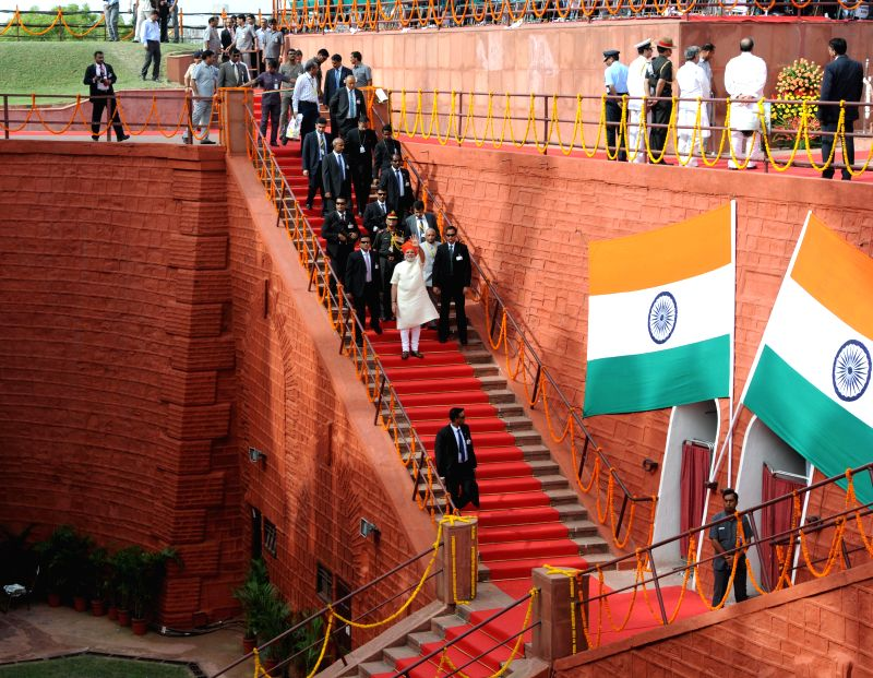 Prime Minister Narendra Modi waves from the staircases of the Red Fort on 68th Independence Day in New Delhi on Aug 15, 2014. - Narendra Modi