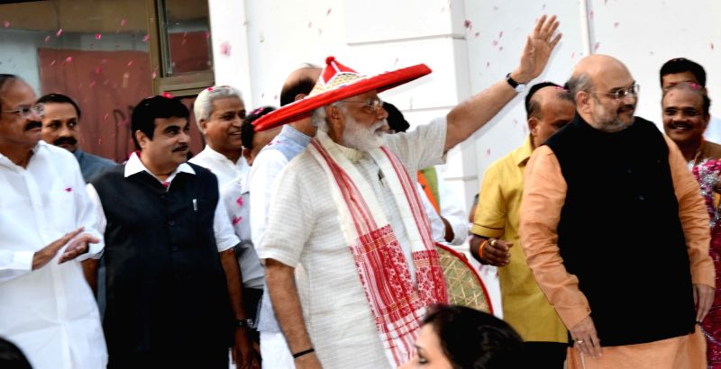 Prime Minister Narendra Modi wearing Japi -a traditional headgear of Assam- with Union Ministers Nitin Gadkari, Venkaiah Naidu and BJP chief Amit Shah at BJP head office in New Delhi on ... - Narendra Modi, Nitin Gadkari, Venkaiah Naidu, B and Amit Shah