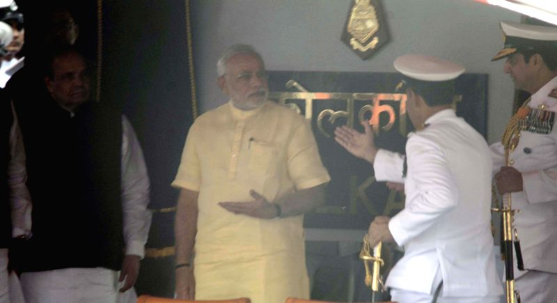 Prime Minister Narendra Modi with Admiral RK Dhowan, Chief of Naval Staff during the commissioning ceremony of INS Kolkata at the Naval Dockyard in Mumbai on August 16, 2014. - Narendra Modi