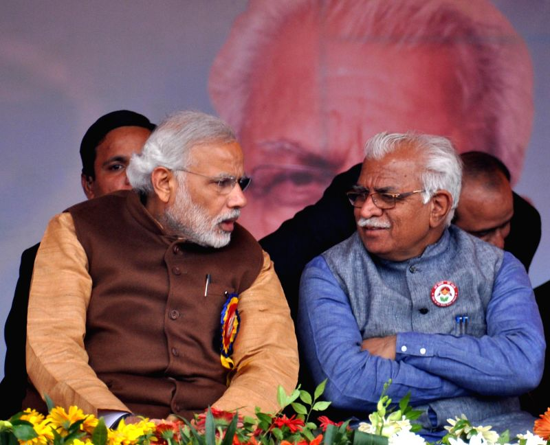Prime Minister Narendra Modi with Haryana Chief Minister Manohar Lal Khattar during `Beti Bachao-Beti Padhao` programme in Panipat, Haryana on Jan 22, 2015. - Narendra Modi and Manohar Lal Khattar