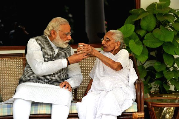 Prime Minister Narendra Modi with his mother Heeraben Modi. (Photo: Twitter/@narendramodi)