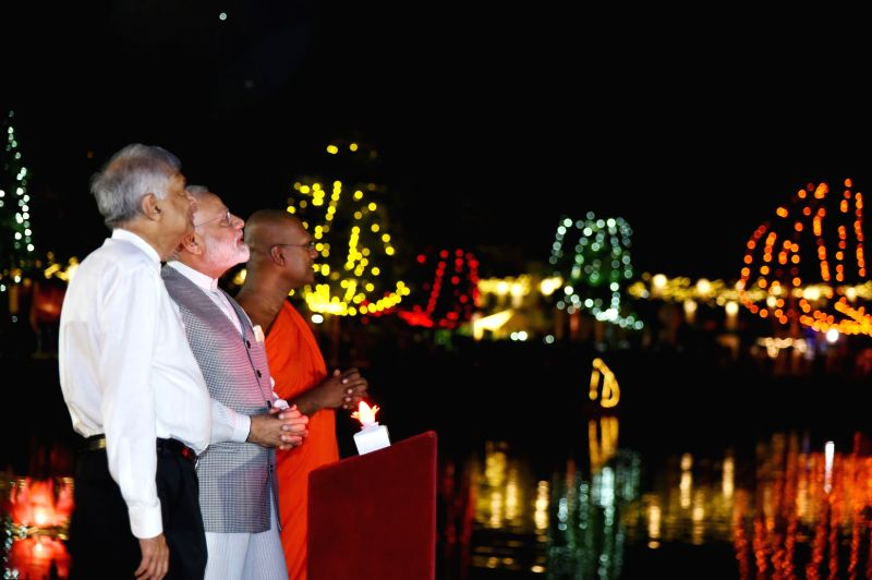 Prime Minister Narendra Modi with his Sri Lankan counterpart Ranil Wickremesinghe during the lamp-lighting ceremony at the Seema Malaka Temple, in Colombo, Sri Lanka on May 11, 2017. - Narendra Modi