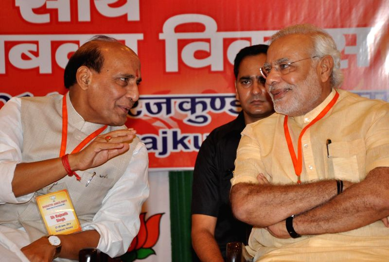 Prime Minister Narendra Modi with home minister Rajnath Singh at the newly elected BJP MPs workshop at Surajkund in Faridabad on June 28, 2014. - Narendra Modi and Rajnath Singh