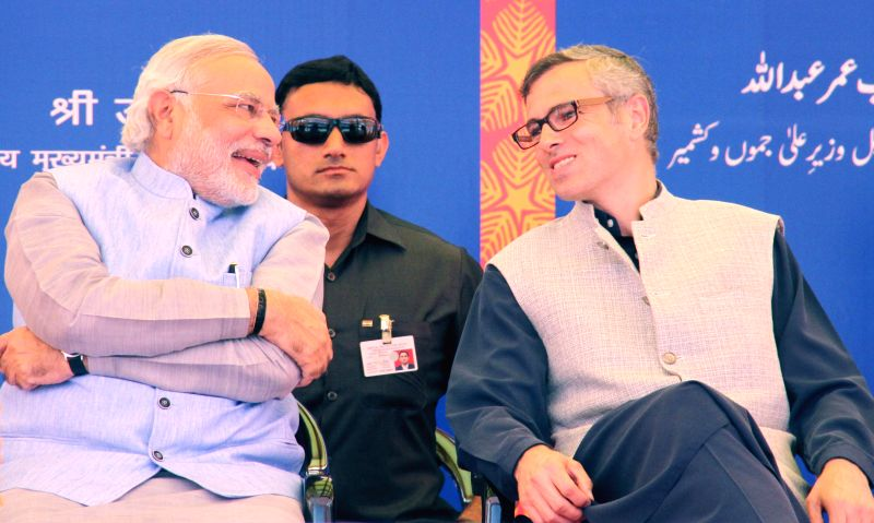 Prime Minister Narendra Modi with Jammu and Kashmir Chief Minister Omar Abdullah during opening ceremony of the newly constructed railway line between Katra-Udhampur Section in Katra of Jammu and ... - Narendra Modi