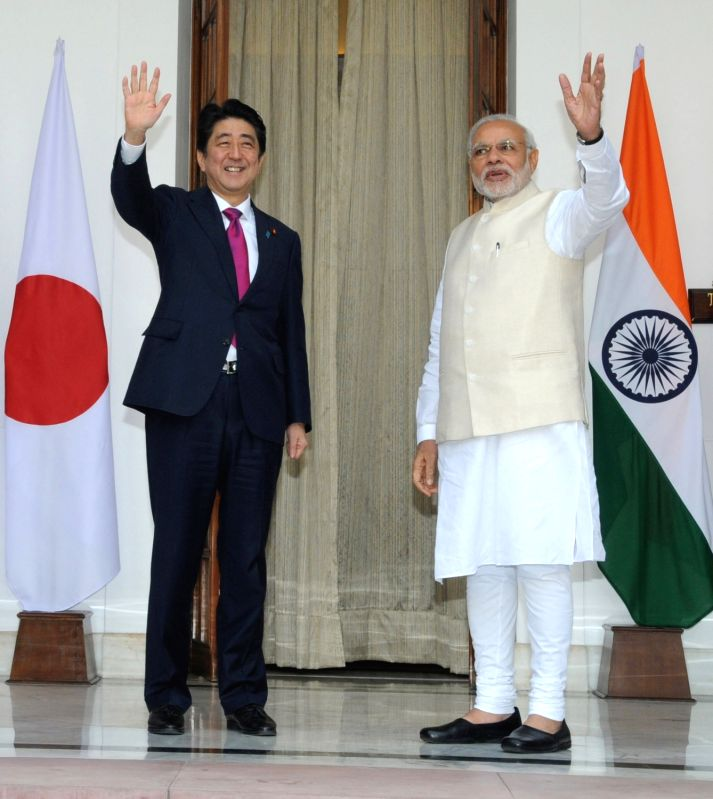 Prime Minister Narendra Modi with Japanese Prime Minister Shinzo Abe, at Hyderabad House, in New Delhi on Dec 12, 2015. - Narendra Modi