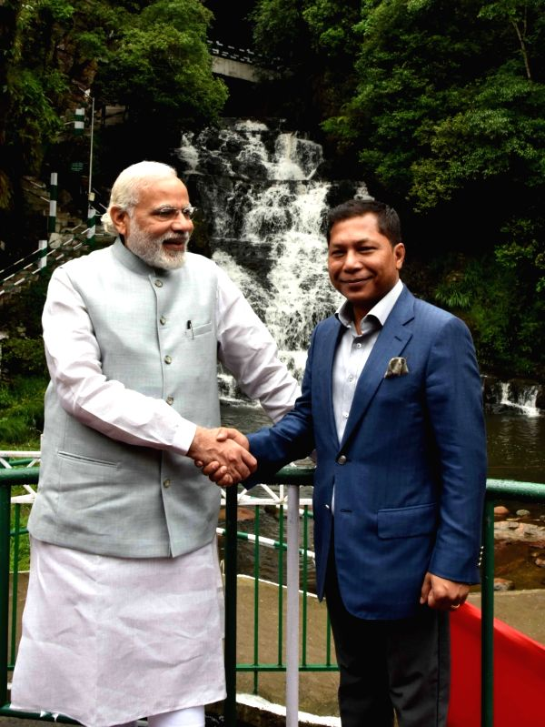 Prime Minister Narendra Modi with Meghalaya Chief Minister Dr. Mukul Sangma at the Elephant Falls, in Meghalaya, on May 28, 2016. - Narendra Modi
