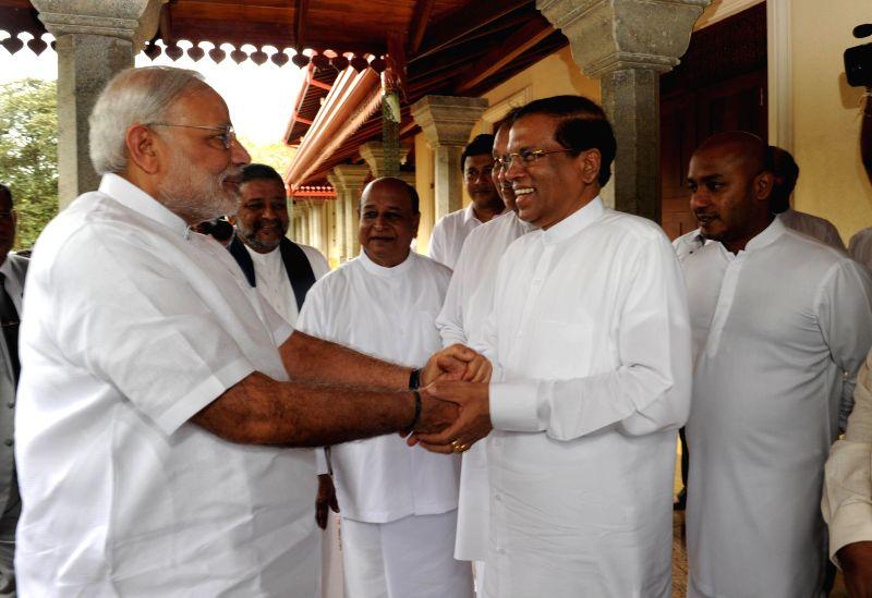 Prime Minister Narendra Modi with Sri Lankan President Maithripala Sirisena during his visit to the Sri Maha Bodhi Tree in Anuradhapura, Sri Lanka  on March 14, 2015. - Narendra Modi