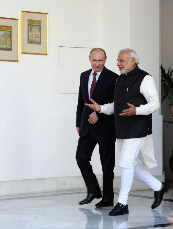 Prime Minister Narendra Modi with the President of the Russian Federation, Vladimir Putin in New Delhi on Dec 11, 2014. - Narendra Modi