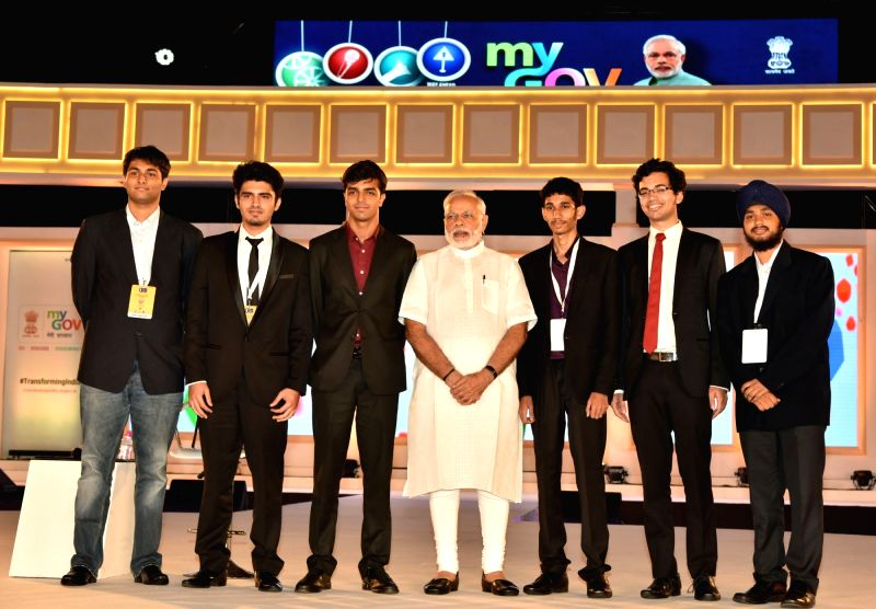 Prime Minister Narendra Modi with the young contributors who developed the new PMO App, at the 2nd Year Anniversary celebrations of MyGov, in New Delhi on Aug 6, 2016. - Narendra Modi