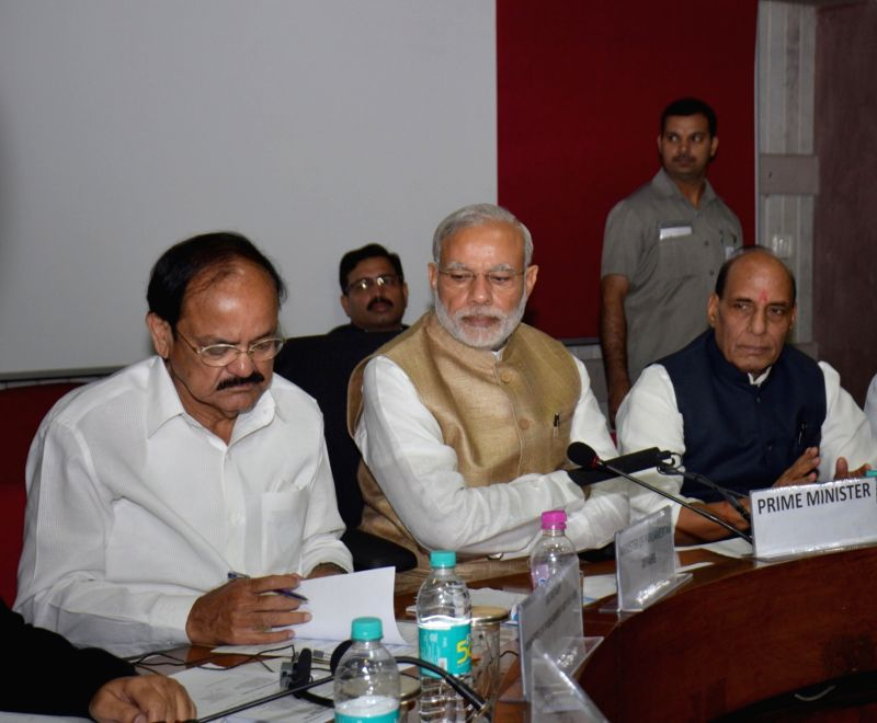 Prime Minister Narendra Modi with Union Minister for Urban Development, Housing and Urban Poverty Alleviation and Parliamentary Affairs M. Venkaiah Naidu and Union Home Minister Rajnath ... - Narendra Modi, M. Venkaiah Naidu and Rajnath Singh