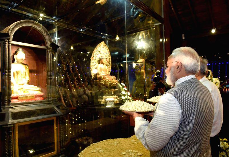 Prime Minister Narendra Modi worship at the Seema Malaka Temple, in Colombo, Sri Lanka on May 11, 2017. - Narendra Modi