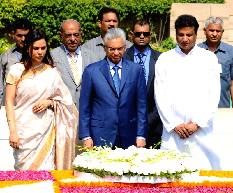 Prime Minister of the Republic of Mauritius Pravind Kumar Jugnauth pays homage at the Samadhi of Mahatma Gandhi, at Rajghat, in Delhi on May 27, 2017. - Pravind Kumar Jugnauth