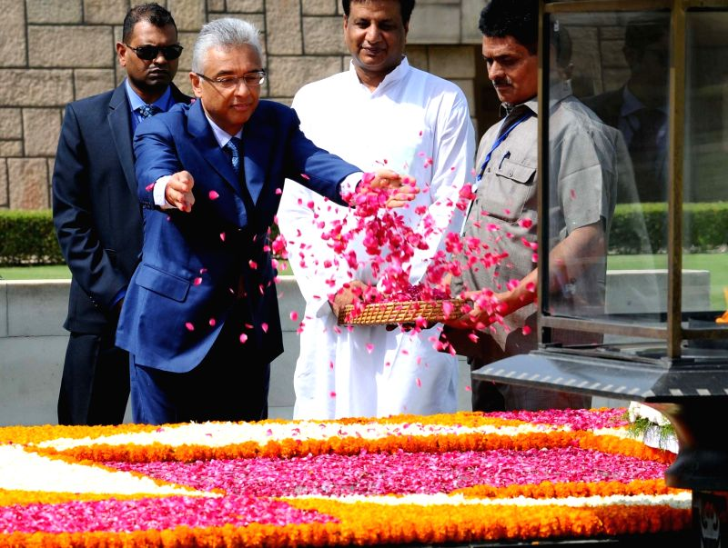 Prime Minister of the Republic of Mauritius Pravind Kumar Jugnauth pays floral tributes at the Samadhi of Mahatma Gandhi, at Rajghat, in Delhi on May 27, 2017. - Pravind Kumar Jugnauth