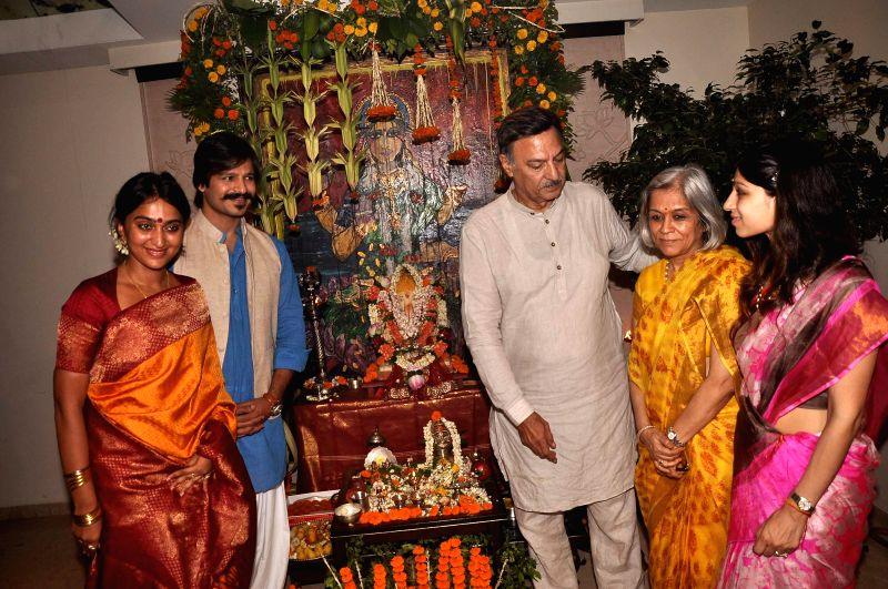 Priyanka Alva Oberoi, Vivek Oberoi, Suresh Oberoi, Yashodhara Oberoi and Meghna Oberoi participate in a procession for the immersion of an idol of the elephant-headed Hindu god Lord Ganesh after ...