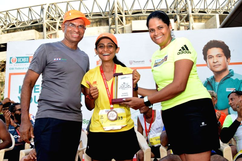 Priyanka Bhatt (C) - winner of the 24 Hour Individual Run (Female).