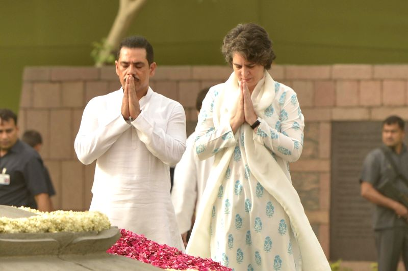 Priyanka Gandhi along with her husband Robert Vadra pays tribute to her father, former prime minister Rajiv Gandhi on his death anniversary at Vir Bhoomi in New Delhi on May 21, 2017. - Rajiv Gandhi and Priyanka Gandhi