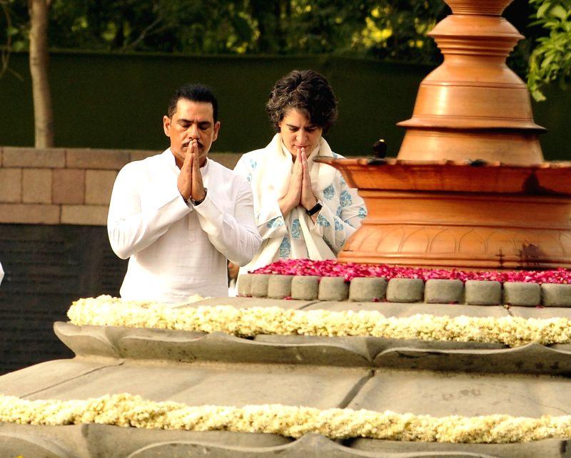 Priyanka Gandhi along with her husband Robert Vadra pays tribute to her father, former prime minister Rajiv Gandhi on his death anniversary at Vir Bhoomi in New Delhi on May 21, 2017. - Rajiv Gandhi and Priyanka Gandhi