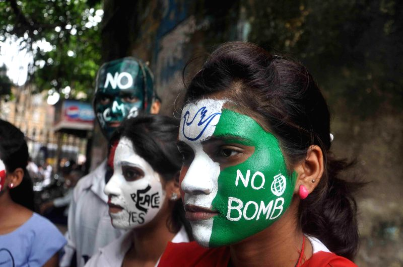 Pro-peace people participate in a rally organised on the 69th anniversary of the US atomic bombings on the Japanese city of Hiroshima, in Mumbai on Aug 6, 2014.