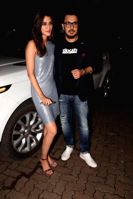 Producer Dinesh Vijan with actress Kriti Sanon during his birthday celebration in Mumbai on July 26, 2018. - Kriti Sanon
