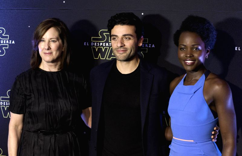 "Producer Kathleen Kennedy (L), and actors Oscar Isaac Hernandez (C) and Lupita Nyong'o, pose during an event to promote the new Star Wars movie ""The Force ... - Oscar Isaac Hernandez"