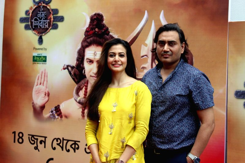 "Producer Nispal Singh and his wife actress Koel Mallick at the launch of upcoming mythological show ""Om Namah Shivay"" in Kolkata, on June 14, 2018. - Koel Mallick and Nispal Singh"