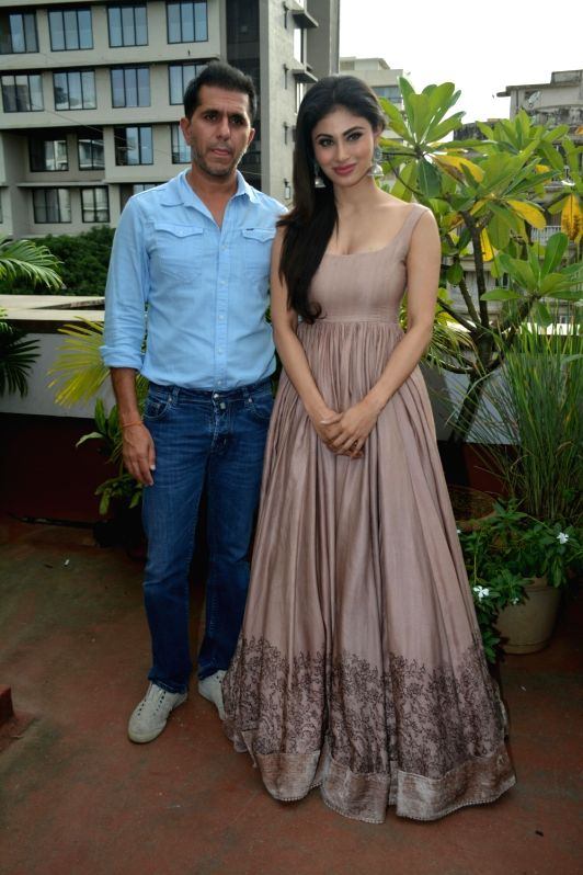 "Producer Ritesh Sidhwani and actress Mouni Roy at the promotion of their upcoming film ""Gold"" in Mumbai on July 31, 2018. - Mouni Roy"