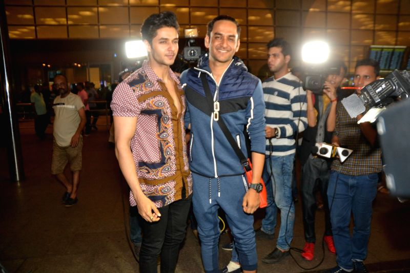 Producer Vikas Gupta and actor Siddharth Gupta leave for Argentina to begin shooting for Khatron Ke Khiladi season 9 in Mumbai on July 11, 2018. - Siddharth Gupta and Vikas Gupta