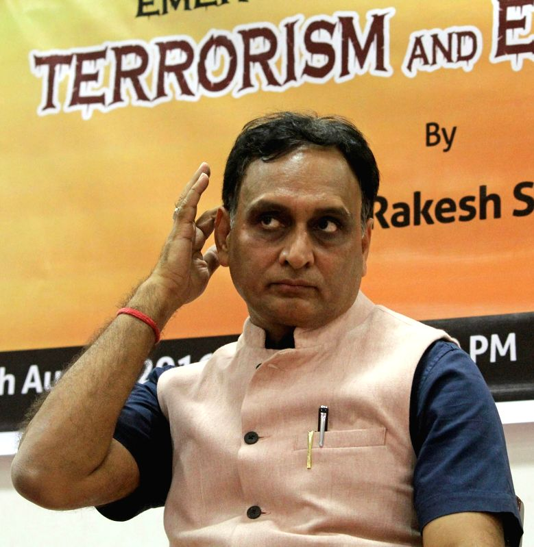 """Prof Rakesh Sinha addresses during a discussion programme on Emerging Challenges of """"Terrorism and Extremism"""" in Bengaluru on Aug. 6, 2016. - Rakesh Sinha"""
