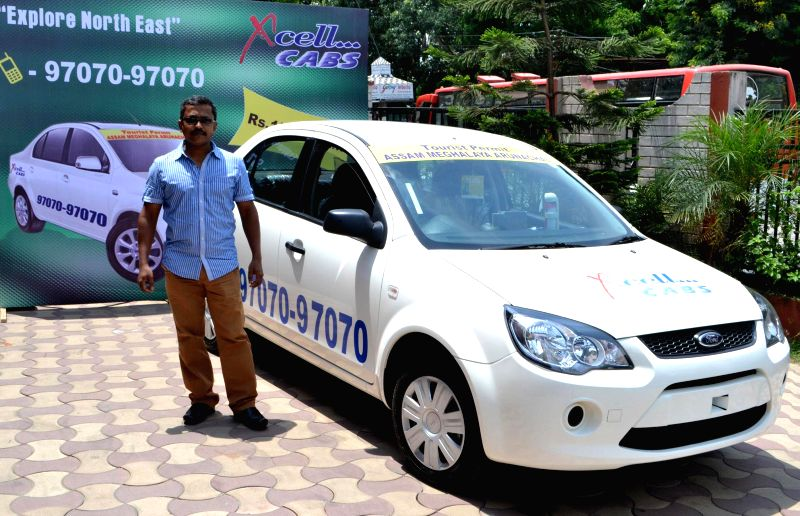 Proprietor of Xcell Cabs Biswajit Mazumder launching his cab services felicitator in Guwahati and North-East in Guwahati on August 02, 2014.