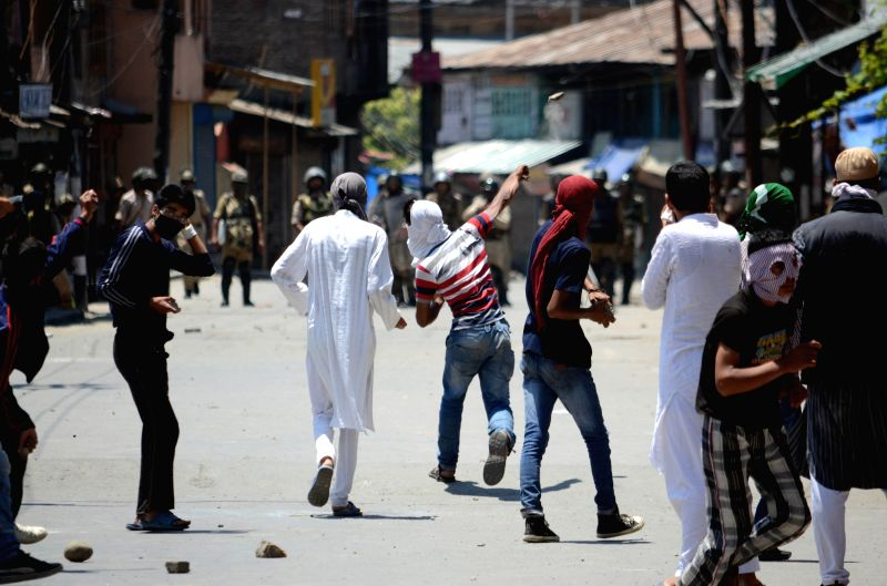 Protesters clash with police during the shutdown called by separatists at Jamia Masjid in Srinagar on June 27, 2015.