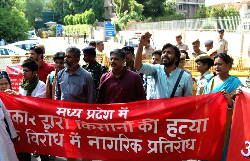Protesters led by All India Kisan Sabha General Secretary Hannan Mollah stage a demonstration outside Madhya Pradesh Bhavan against killing of farmers of Madhya Pradesh's Mandsaur; in New ...