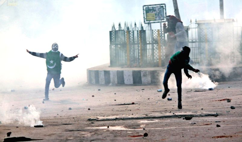Protesters pelt stones a on security personnel  in Srinagar, on Dec 4, 2015.