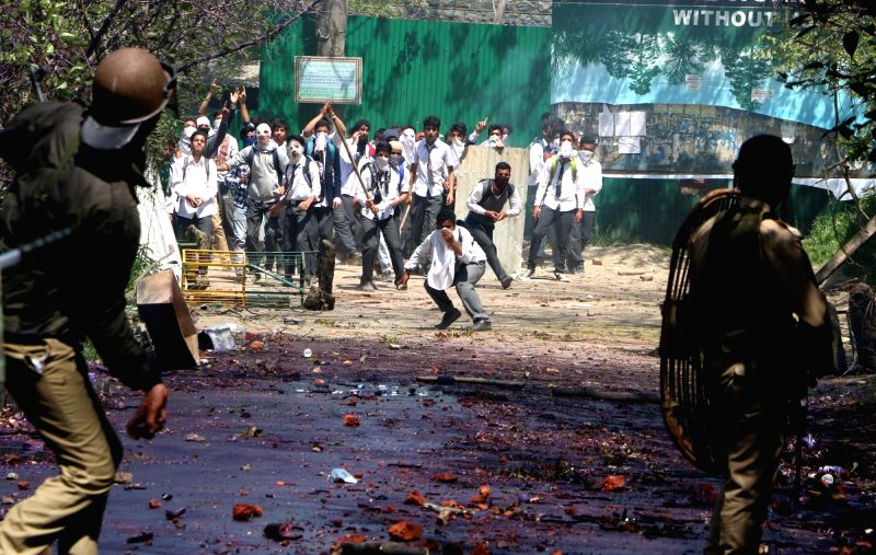 Protesters pelt stones on security personnel in Srinagar on April 17, 2017.