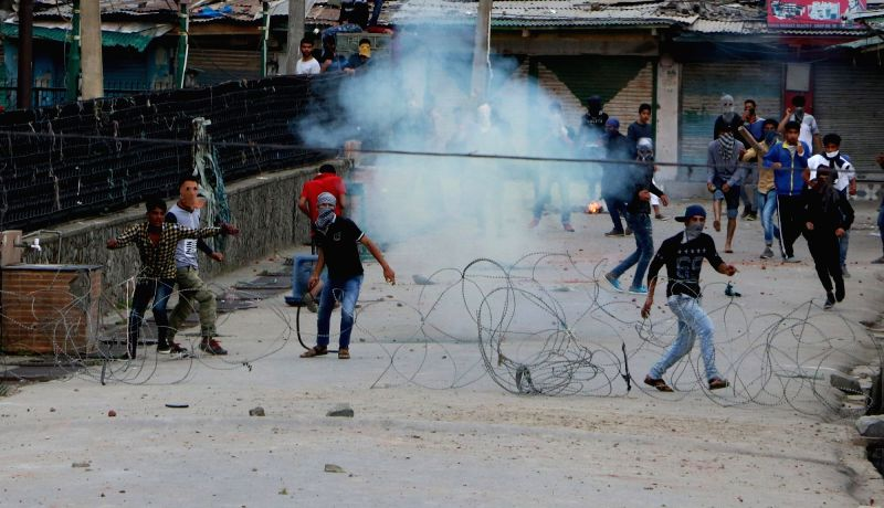 Protesters pelt stones on security personnel in Srinagar, on May 12, 2017.