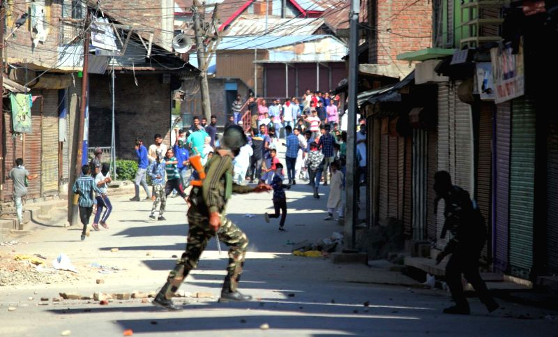 Protesters pelt stones on security personnel in Sopore of Jammu and Kashmir on June 9, 2017.