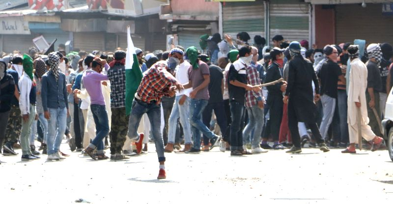 Protesters pelt stones on security personnel in Srinagar on June 8, 2018.
