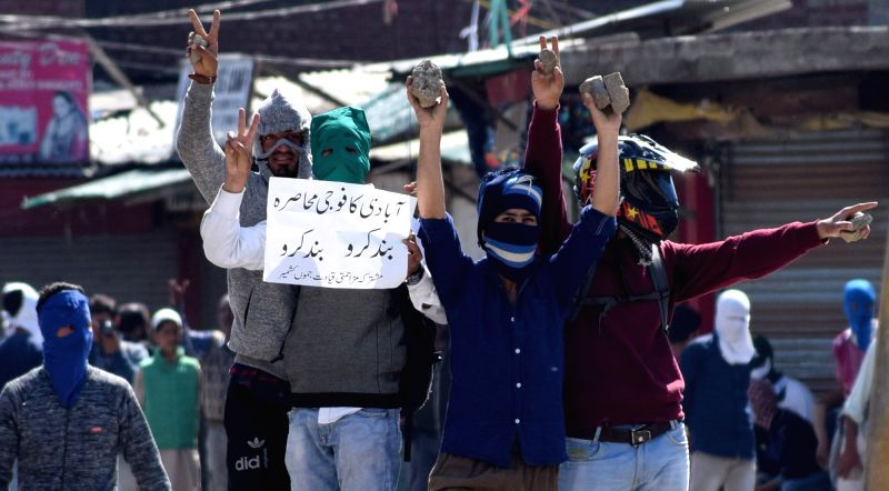 Protesters stage a demonstration holding bricks in Srinagar on May 5, 2017.