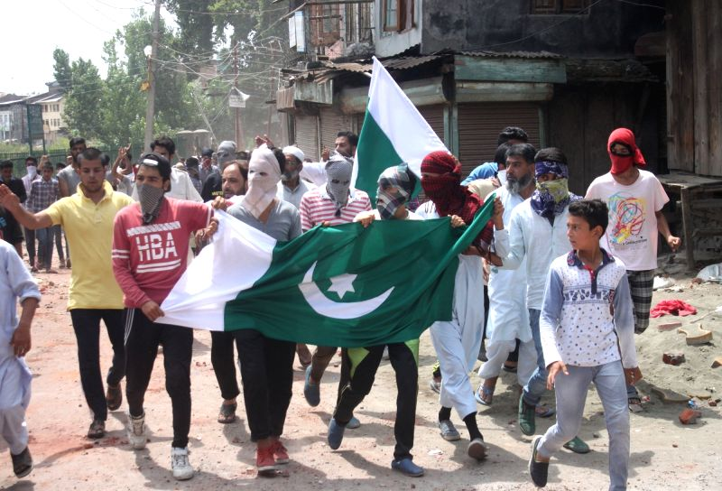 Protesters wave Pakistan flags during a demonstration in Srinagar on Aug 6, 2016.
