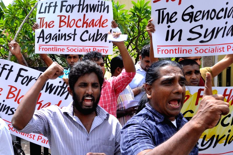 Protestors from the Frontline Socialist Party (FLSP) attend a rally outside the U.S. Embassy in Colombo, Sri Lanka, Oct. 28, 2015. Hundreds of protestors from the ...