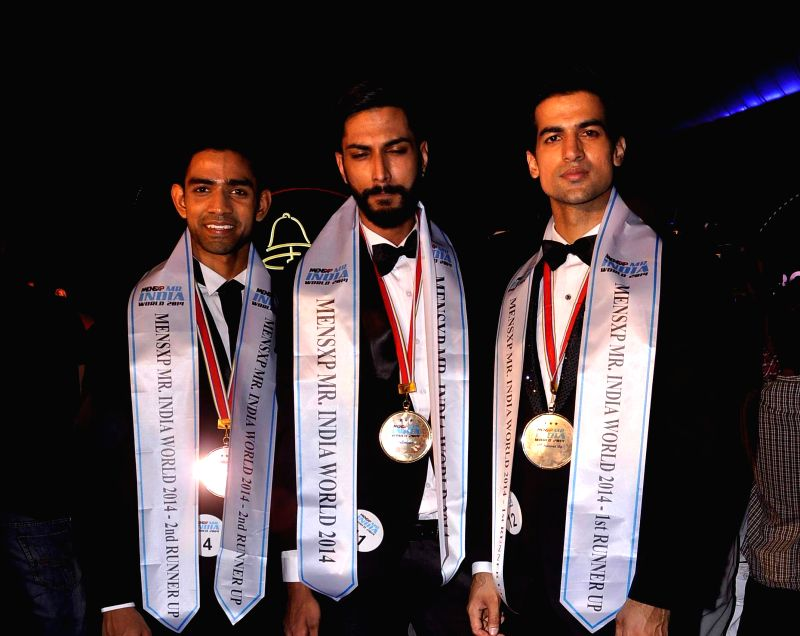 Provogue Men Mr India 2014 finale 2nd runner up Bharat Raj, winner Pratik Jain and 1st runner up Puneet Beniwal during the Provogue Mr India 2014 finale in Mumbai, on May 8, 2014. - Pratik Jain