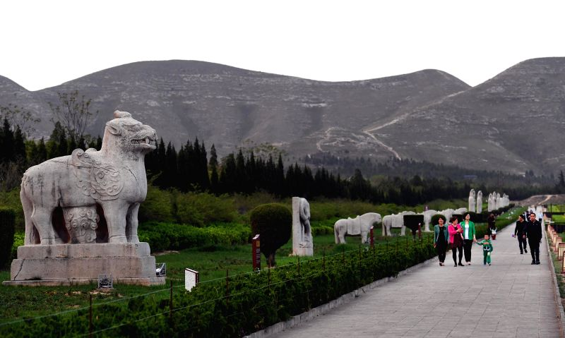 PUCHENG, April 18, 2017 - Tourists visit the Qiaoling archaeological park in Pucheng County, northwest China's Shaanxi Province, April 17, 2017. Qiaoling Tomb is for Li Dan, Emperor Rui Zong of Tang ...