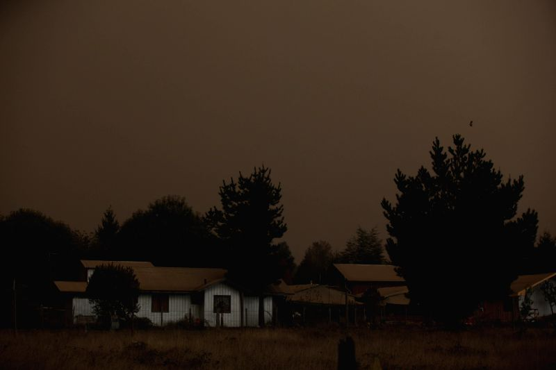 Houses are covered by ash from the eruption of Calbuco volcano in the town of Pucon in southern Chile, on April 23, 2015. The volcano erupted Wednesday afternoon for ...
