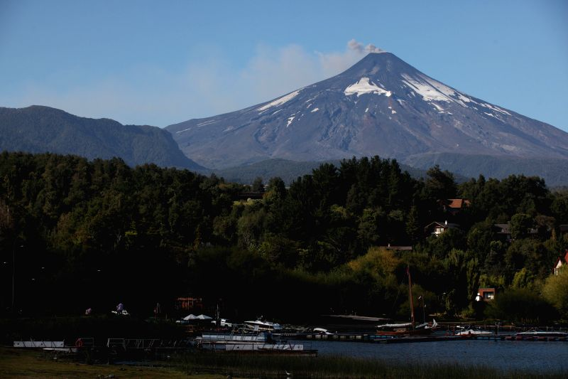 Smoke and ash rises from the Villarrica volcano, located 18 km south Pucon and 128 km southeast Temuco, La Araucania region, Chile, on March 18, 2015. National ...