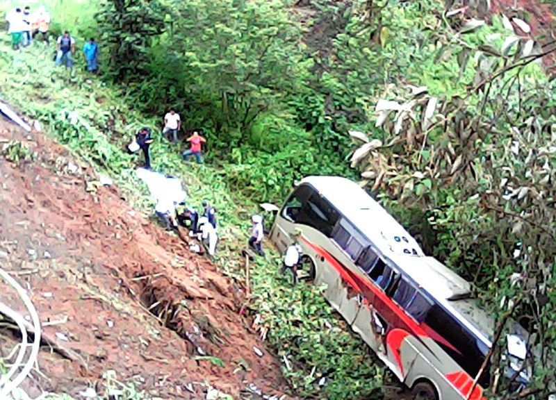 PUEBLA, Aug. 8, 2016 - Rescuers check a damaged passenger bus falling into a ravine after heavy rains brought by tropical strom Earl, in the state of Puebla, Mexico, on Aug. 7, 2016. Tropical storm ...