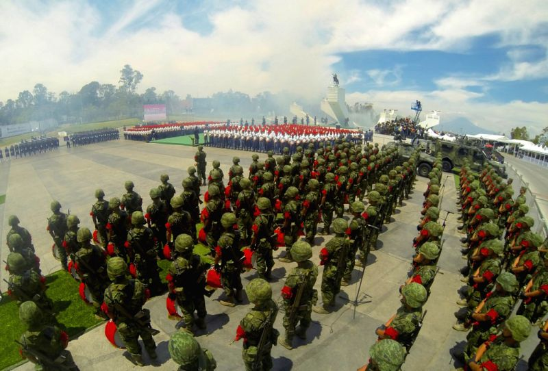 Image provided by the Mexican Presidency shows Mexican soldiers taking part in the Civic-Military Parade to commemorate the 152nd anniversary of the Battle of Puebla, .