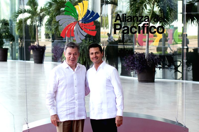 PUERTO VALLARTA, July 25, 2018 - Mexico's President Enrique Pena Nieto (R) and Colombia's President Juan Manuel Santos pose for photos prior to a meeting during the 13th Pacific Alliance Summit in ...