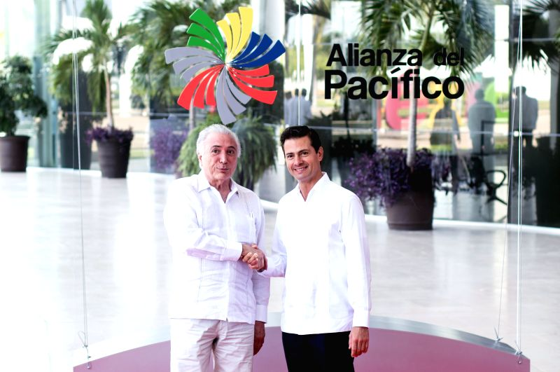 PUERTO VALLARTA, July 25, 2018 - Mexico's President Enrique Pena Nieto (R) and Brazil's President Michel Temer pose for photos prior to a meeting during the 13th Pacific Alliance Summit in Puerto ...